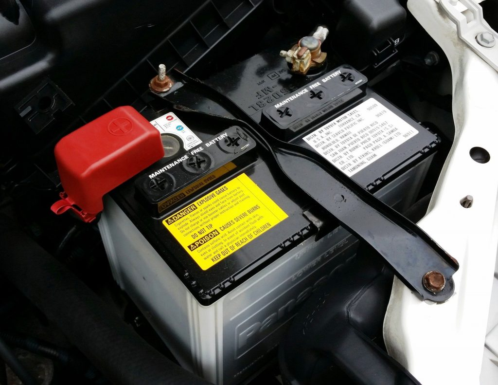 Close up of car battery screwed to the car's bonnet
